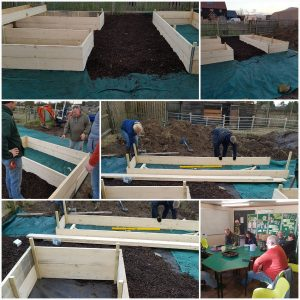 Volunteers building the community allotment